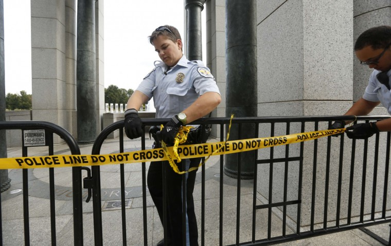 U.S. Park Police close off the World War II Memorial in Washington October 1, 2013. The U.S. government began a partial shutdown on Tuesday for the first time in 17 years, potentially putting up to 1 million workers on unpaid leave, closing national parks and stalling medical research projects. (Kevin Lamarque/Reuters photo)