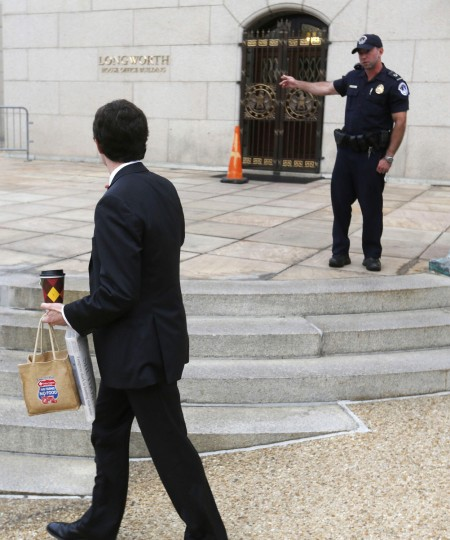 A U.S. Capitol police officer refuses entry into the Longworth House Office Building on Capitol Hill in Washington, after the U.S. government shut down October 1, 2013. The U.S. government began a partial shutdown on Tuesday for the first time in 17 years, potentially putting up to 1 million workers on unpaid leave, closing national parks and stalling medical research projects. (Larry Downing/Reuters photo)