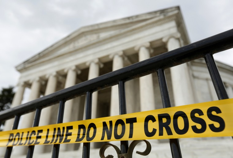 The Jefferson Memorial is seen with its entry closed off in Washington October 1, 2013. The U.S. government began a partial shutdown on Tuesday for the first time in 17 years, potentially putting up to 1 million workers on unpaid leave, closing national parks and stalling medical research projects. (Kevin Lamarque/Reuters photo)