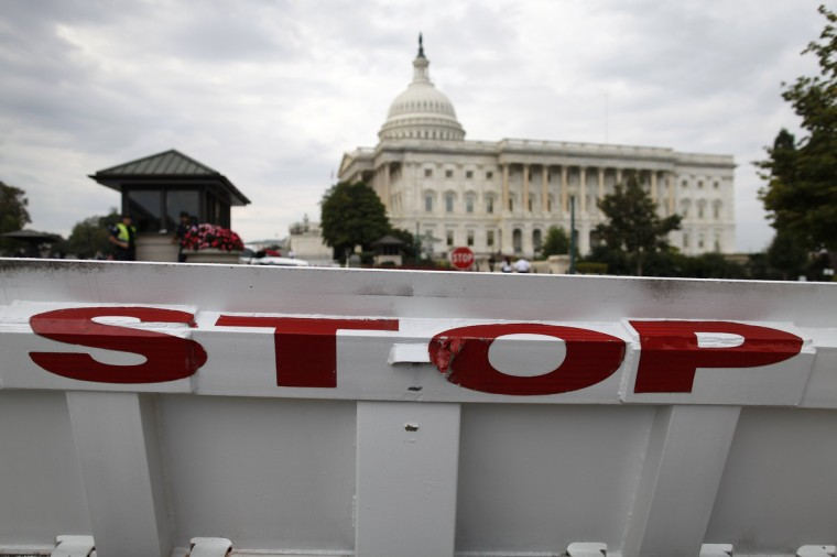 A security barricade stops traffic on the Senate side of the U.S. Capitol in Washington, October 1, 2013. The U.S. government began a partial shutdown for the first time in 17 years, potentially putting up to 1 million workers on unpaid leave, closing national parks and stalling medical research projects. (/Jonathan Ernst/Reuters photo)