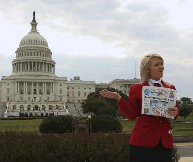 Abigail Welch, a member of the Family, Career and Community Leadership of America group, poses in front of the U.S. Capitol in Washington on day one of the government shutdown October 1, 2013. (Gary Cameron/Reuters photo)