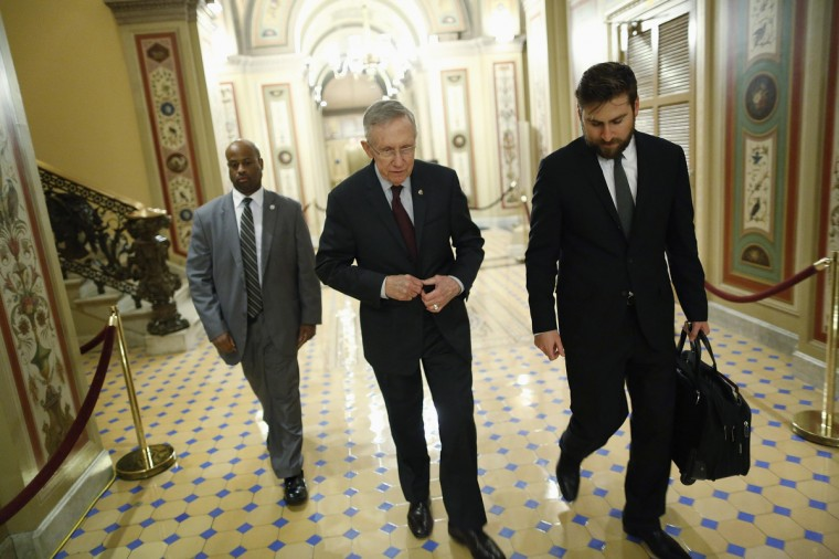 U.S. Senate Majority Leader Harry Reid (D-NV) (C) departs with an aide and his security detail after talks with the Republican-controlled U.S. House of Representatives reached a final impasse during a late-night session at the U.S. Capitol in Washington, October 1, 2013. (Jonathan Ernst/Reuters photo)