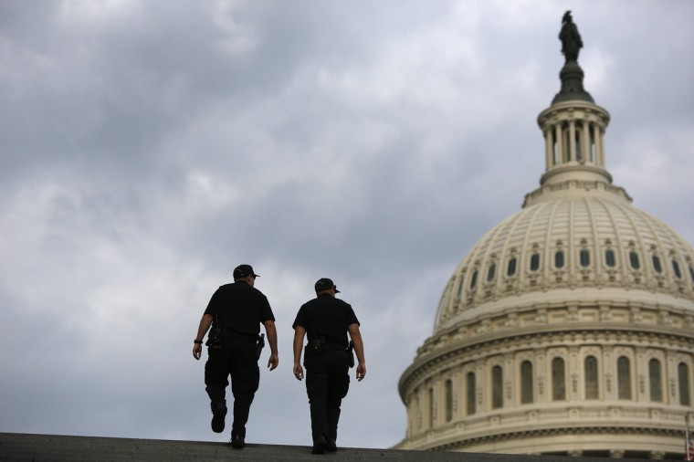 U.S. Capitol Police return to patrol after a brief meeting to discuss how to handle tourists turned away from the shuttered visitor's center at the U.S. Capitol in Washington, October 1, 2013. (Jonathan Ernst/Reuters photo)