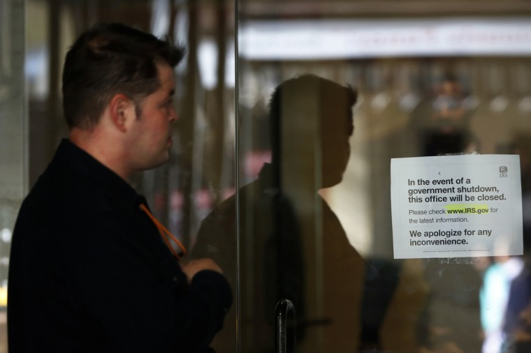 A man views a sign warning that the Internal Revenue Service building is closed at their offices in New York October 1, 2013. The U.S. government began a partial shutdown on Tuesday for the first time in 17 years, potentially putting up to 1 million workers on unpaid leave, closing national parks and stalling medical research projects. (Shannon Stapleton/Reuters photo)