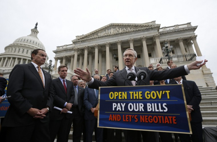 U.S. Senate Majority Leader Harry Reid (D-NV) gathers with other Democratic Party senate members and Washington D.C. Mayor Vincent Gray (L) on the steps of the U.S. Capitol in Washington, October 9, 2013. Reid called on Republican members of congress to negotiate an end to the U.S. Government shutdown entering its ninth day. (Jason Reed/Reuters)