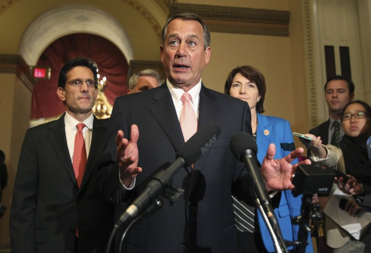 "Speaker of the House John Boehner speaks to the media at 1:00 am with U.S. House Majority Leader Eric Cantor (R-VA) (L) at his side after the House of Representatives voted to send their funding bill with delays to the ""Obamacare"" health care act into a conference with the Senate, prompting a shutdown of portions of the U.S. government in Washington. (Jim Bourg/Reuters photo)"