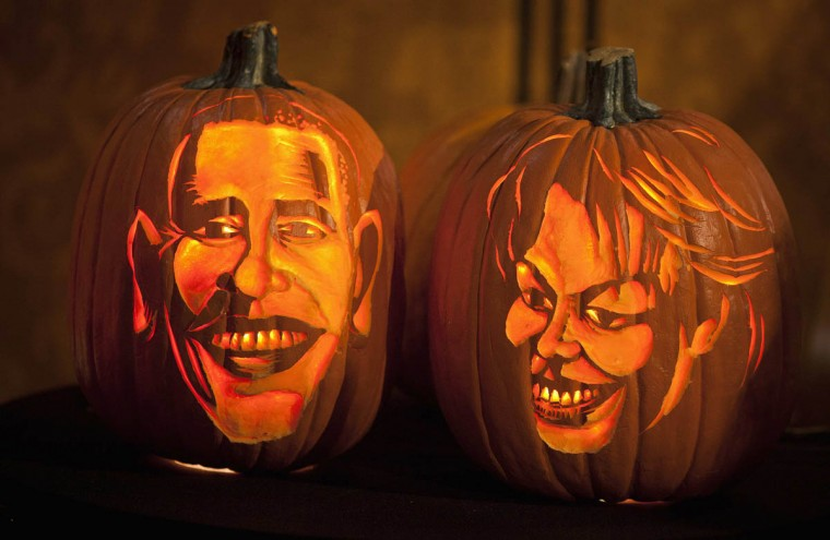 Pumpkins carved in the likeness of U.S. President Barack Obama and first lady Michelle Obama are lit at Madame Tussauds in New York, October 22, 2013. (Carlo Allegri/Reuters photo)