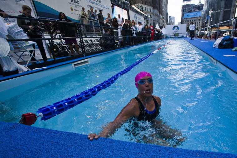 U.S. long-distance swimmer Diana Nyad takes a breath during her 48-hour continuous swim at Herald Square in New York, October 8, 2013. According to a media release, Nyad is holding the 48 hour continuous swim to support Hurricane Sandy recovery efforts.(Eduardo Munoz/Reuters)