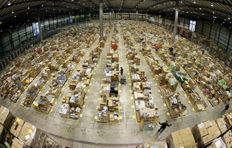 Workers are seen in the Amazon.co.uk warehouse in Milton Keynes, north of London November 17, 2006. (Dylan Martinez/Reuters)