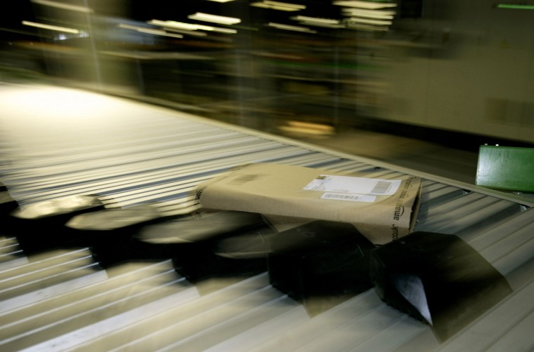 Parcels move along a conveyor belt in the Amazon.co.uk warehouse in Milton Keynes, north of London November 17, 2006. (Dylan Martinez/Reuters)
