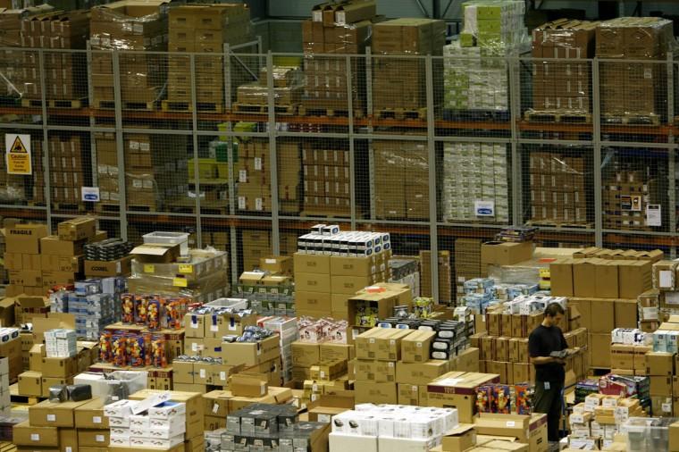 A worker is seen in the Amazon.co.uk warehouse in Milton Keynes, north of London November 17, 2006. (Kieran Doherty/Reuters)