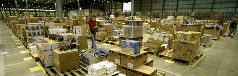 A worker is seen in the Amazon.co.uk warehouse in Milton Keynes, north of London November 17, 2006. (Dylan Martinez/Reuters)