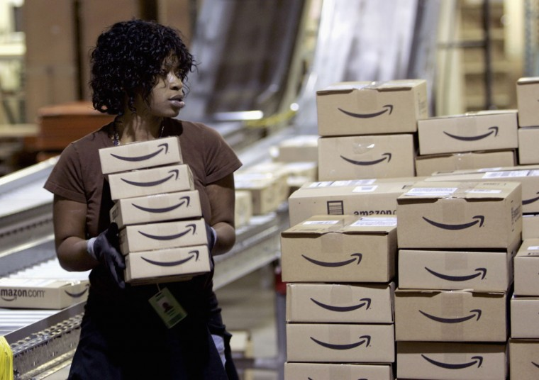 A worker loads a shipment of outgoing boxes at the Amazon.com warehouse facility in New Castle, Delaware, November 24, 2006. The November-December holiday shopping season is the most important period for U.S. Retailers. (Tim Shaffer/Reuters)