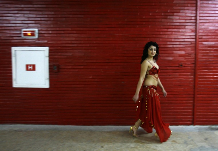 "A Romanian Roma (gypsy) girl, participant in the ""Miss Piranda"" contest, arrives for a news conference announcing the forthcoming competition in Bucharest January 31, 2007. The ""Miss Piranda"" contest jury will base their decision on not just the contestants' beauty, but also on their gypsy belly dancing skills. (Bogdan Cristel/Reuters)"