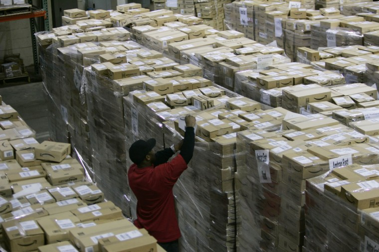 A worker checks a shipment of outgoing boxes at the Amazon.com warehouse facility in New Castle, Delaware, November 24, 2006. The November-December holiday shopping season is the most important period for U.S. retailers. (Tim Shaffer/Reuters)