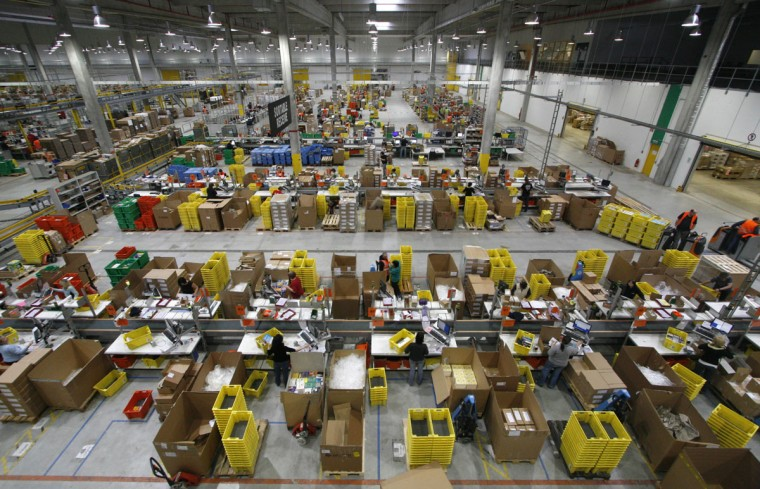 Workers sort packages at the Amazon warehouse in Leipzig, December 3, 2008. The shelves at the company's warehouse become full during the busiest time of the year before Christmas. (Fabrizio Bensch/Reuters)