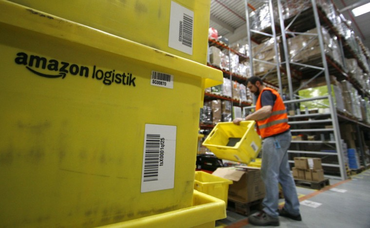 A worker sorts packages at the Amazon warehouse in Leipzig, December 3, 2008. The shelves at the company's warehouse become full during the busiest time of the year before Christmas. (Fabrizio Bensch/Reuters)