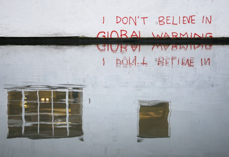 Graffiti art is seen on a wall next to the Regent's Canal, in Camden in London on December 22, 2009. (REUTERS/Luke MacGregor )