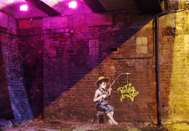 Graffiti art is seen on a wall in Camden in London on December 22, 2009. (REUTERS/Luke MacGregor )