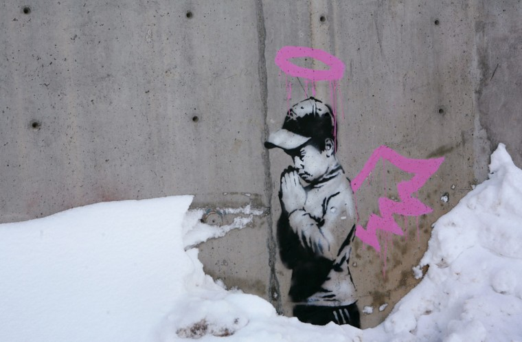 Artwork by the artist Banksy is shown on a wall during the Sundance Film Festival in Park City, Utah on January 22, 2010. (REUTERS/Robert Galbraith )