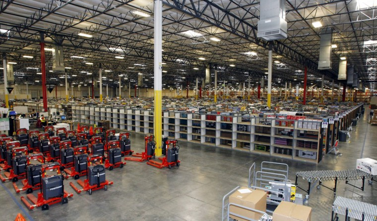 "Merchandise sits at the Amazon Phoenix Fulfillment Center in Goodyear, Arizona, in this file image from November 16, 2009. The White House on January 29, 2010 hailed a report of 5.7 percent economic growth in the fourth quarter as ""the most positive news to date on the economy"" and said the Obama administration's focus must remain on job creation. (Rick Scuteri/Reuters)"