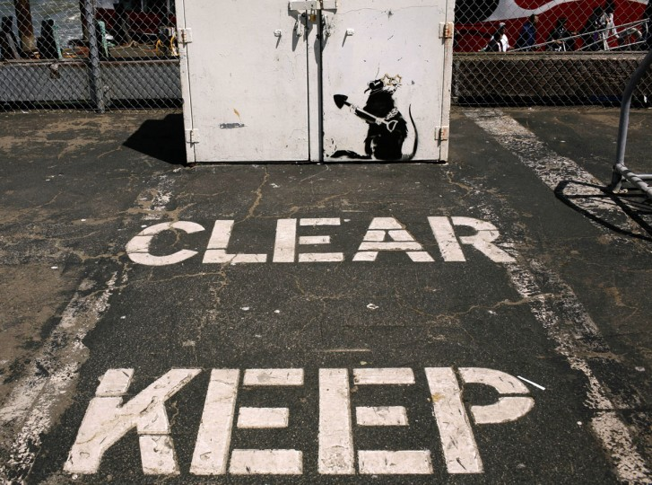 A painting of a rat, believed to be the work of elusive British street artist Banksy, in the Fishermen's Wharf area in San Francisco, California on May 4, 2010. (REUTERS/Robert Galbraith)