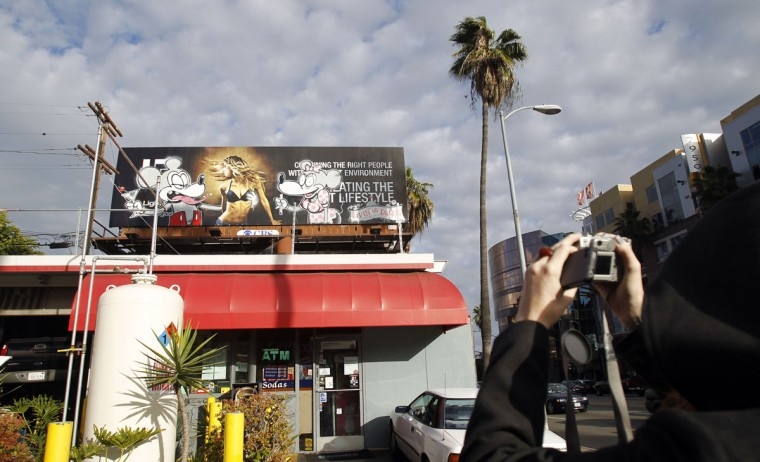 An artwork painted on a billboard is seen in Los Angeles on February 16, 2011. (REUTERS/Mario Anzuoni)