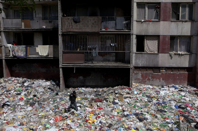 A Roma boy walks through rubbish behind houses at the Lunik IV settlement unit in Kosice, east Slovakia May 25, 2011. Some 7,000 Roma inhabit the neighbourhood. (Petr Josek/Reuters)