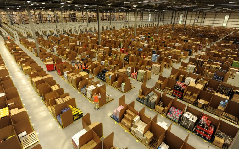 Work is carried out at Amazon's new fulfilment centre after it was opened by Scotland's First Minister Alex Salmond in Dunfermline, Scotland, November 15, 2011.The warehouse covers more than one million square feet (93,000 square metres), about the size of 14 soccer pitches, and is Amazon?s biggest in the United Kingdom. It will create 750 permanent jobs, along with a further 1,500 temporary jobs during peak periods. (Russell Cheyne/Reuters)