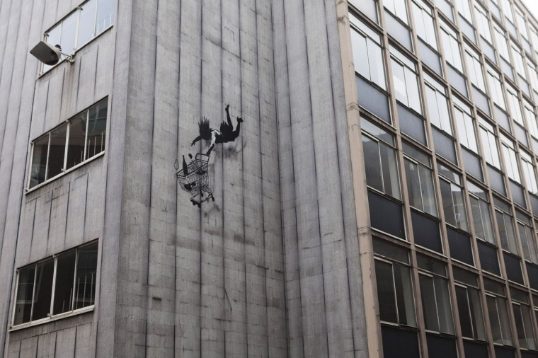 A recent work by the street artist Banksy adorns the side of a building in the Mayfair area of London on February 4, 2012. (REUTERS/Finbarr O'Reilly)