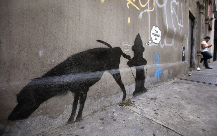 New artwork by British graffiti artist Banksy is seen on