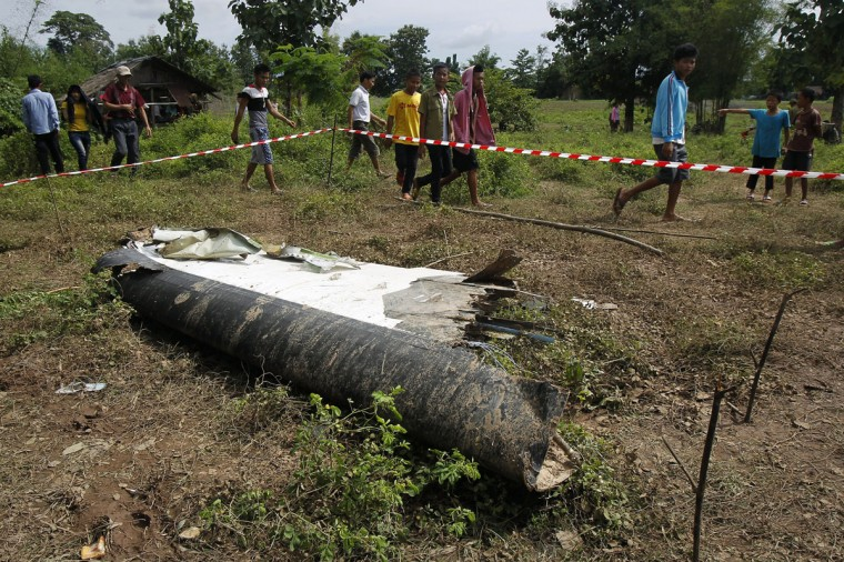 People arrive at the crash site of an ATR-72 turboprop plane, in Laos. (REUTERS/Chaiwat Subprasom)