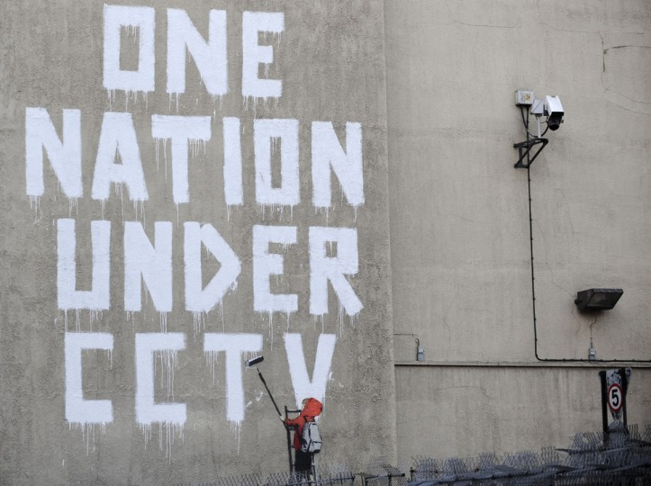 Street graffiti by elusive graffiti artist Banksy is seen on a wall, next to a CCTV camera, in central London on November 25, 2008. (REUTERS/Toby Melville)