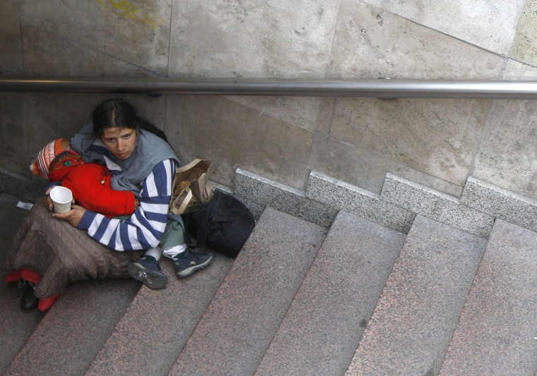 A Roma woman holds her child as she begs on a staircase in the centre of Budapest, May 6, 2009. Hungary remains one of the hardest hit countries in central and eastern Europe by the global economic crisis. (Laszlo Balogh/Reuters)