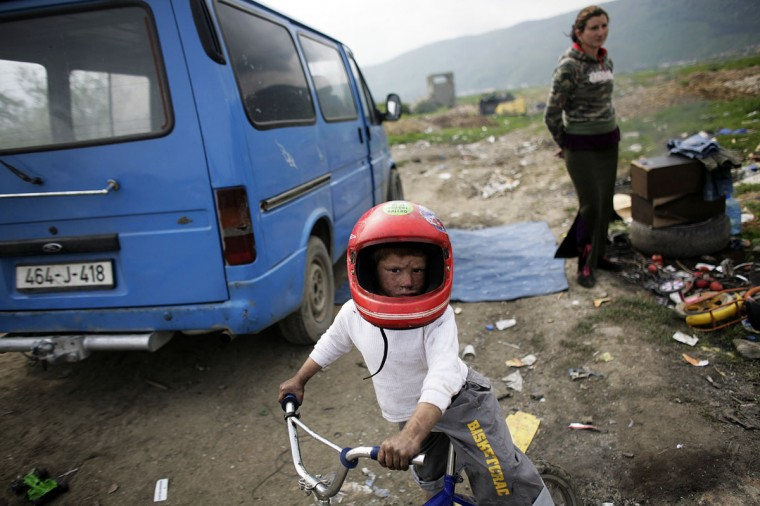 Roma boy wears a helmet on St. George's Day or Djurdjevdan in the Roma settlement in Sarajevo's suburb of Butmir May 6, 2009. Members of the Roma minority in Bosnia celebrated their biggest holiday St. George's Day by slaughtering lambs for the dinner feast and spending the day with relatives and neighbours. (Damir Sagolj/Reuters)