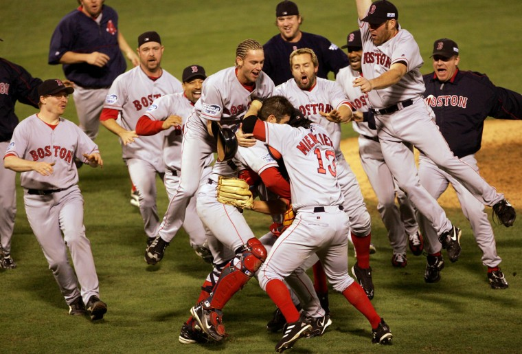 The Boston Red Sox celebrate after defeating the St. Louis Cardinals 3-0 to win game four of the World Series on October 27, 2004 at Busch Stadium in St. Louis, Missouri. (Stephen Dunn/Getty Images)