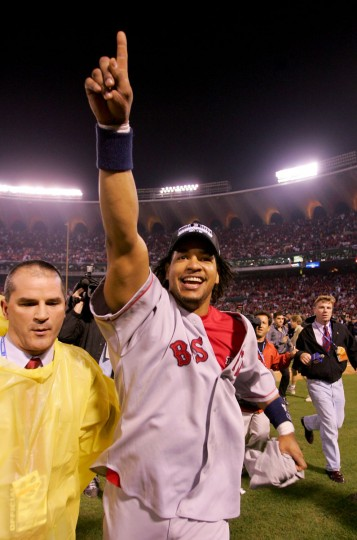 ST LOUIS - OCTOBER 27: Manny Ramirez #24 of the Boston Red Sox celebrates after defeating the St. Louis Cardinals 3-0 to win game four of the World Series on October 27, 2004 at Busch Stadium in St. Louis, Missouri. (Ezra Shaw/Getty Images)