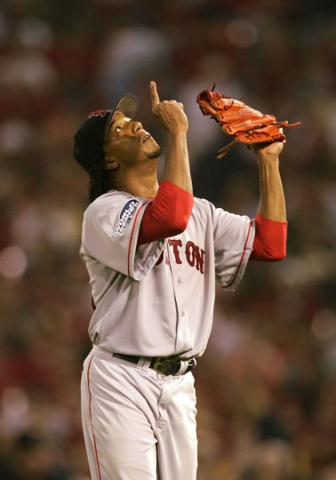 Pedro Martinez #45 of the Boston Red Sox points the sky after being taken out of game three of the World Series against the St. Louis Cardinals on October 26, 2004 at Busch Stadium in St. Louis, Missouri. (Al Bello/Getty Images)