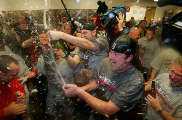 Pitchers Derek Lowe #32 and Bronson Arroyo #61 of the Boston Red Sox celebrate in the locker room after defeating the St. Louis Cardinals 3-0 to win game four of the World Series on October 27, 2004 at Busch Stadium in St. Louis, Missouri. (Ezra Shaw/Getty Images)