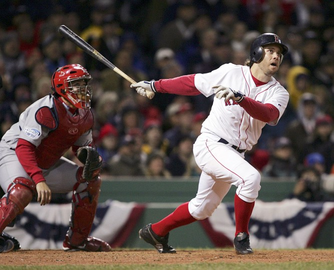 Boston Red Sox's Mark Bellhorn hits an eighth inning two-run home run off St. Louis Cardinals' Julian Tavarez in Game 1 of the World Series in Boston, Saturday, Oct. 23, 2004. (Charles Krupa/AP Photo)