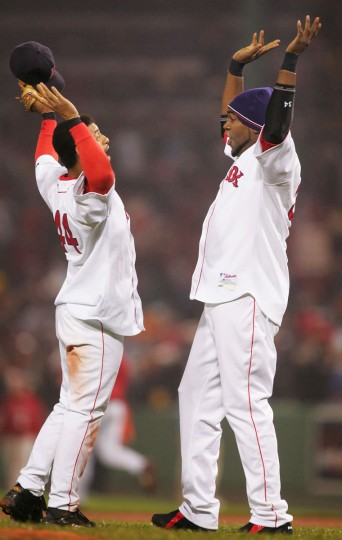 David Ortiz #34 of the Boston Red Sox and teammate Orlando Cabera #44 celebrate winning game two of the World Series on October 24, 2004 at Fenway Park in Boston, Massachusetts. The Boston Red Sox defeated the St. Louis Cardinals 6-2 to take a 2-0 game lead.(Ezra Shaw/Getty Images)