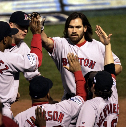 Boston Red Sox's Johnny Damon, right, is congratulated by teammates after his first inning solo home run against St. Louis Cardinals pitcher Jason Marquis in Game 4 of the World Series at Busch Stadium in St. Louis, Wednesday, Oct. 27, 2004. (Mark Humphrey/AP Photo)