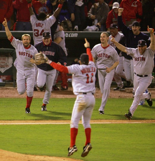 The Boston Red Sox celebrate after defeating the St. Louis Cardinals 3-0 to win game four of the World Series on October 27, 2004 at Busch Stadium in St. Louis, Missouri. (Elsa/Getty Images)