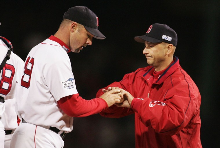 Piitcher Tim Wakefield #49 of the Boston Red Sox is taken out of the game in the fourth inning by manager Terry Francona #47 against the St. Louis Cardinals during game one of the World Series on October 23, 2004 at Fenway Park in Boston, Massachusetts. (Al Bello/Getty Images)