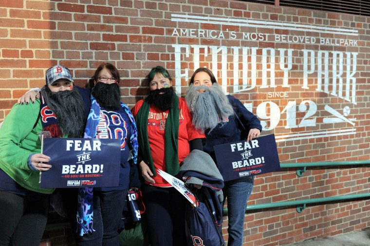 Boston Red Sox fans Kaitlen Beauchamp , Elizabeth Beauchamp , Ellie Longtin, and Kellie Longtin wear beards prior to game one of the MLB baseball World Series against the St. Louis Cardinals at Fenway Park. (Angie Walton/USA TODAY Sports)