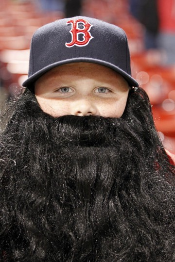 Boston Red Sox fan Jack Schwartz Wayland, age 13, wears a beard prior to game one of the MLB baseball World Series against the St. Louis Cardinals at Fenway Park. (Greg M. Cooper/USA TODAY Sports)