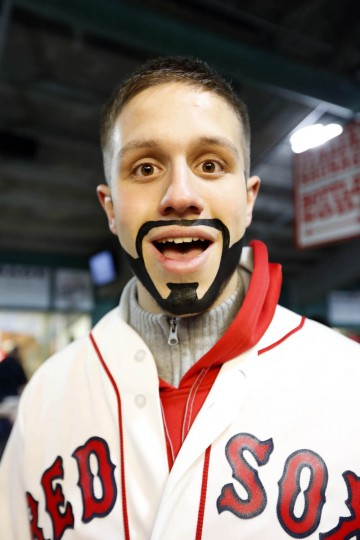 Morgan Theriault, from Leominster, Ma, with a beard painted on his face, prior to game one of the MLB baseball World Series against the St. Louis Cardinals at Fenway Park. (Greg M. Cooper/USA TODAY Sports)