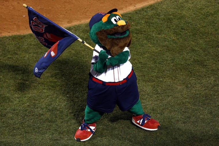 Boston Red Sox mascot Wally celebrates after defeating the St. Louis Cardinals during game one of the MLB baseball World Series at Fenway Park. Boston won 8-1. (Mark L. Baer/USA TODAY Sports)