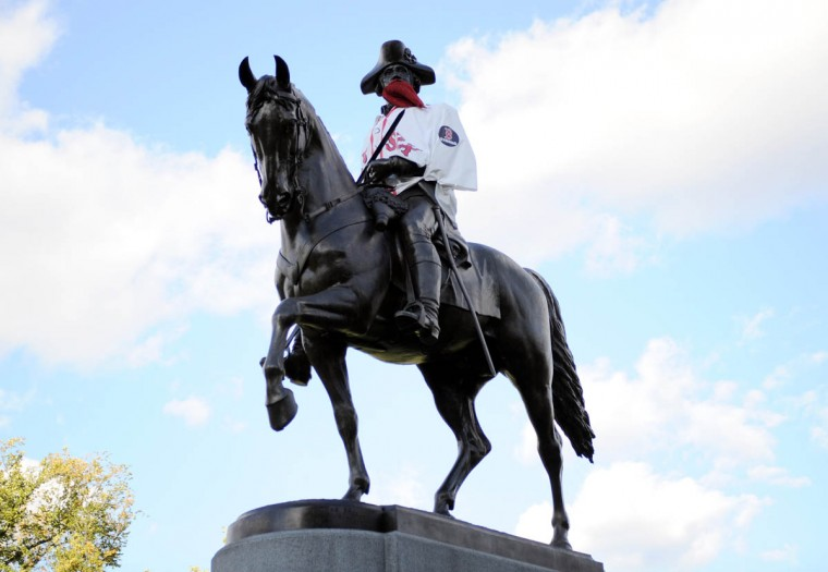 The George Washington statue in the Boston Public Gardens is dressed in a Boston Red Sox jersey before game two of the MLB baseball World Series against the St. Louis Cardinals at Fenway Park. (Angie Walton/USA TODAY Sports)
