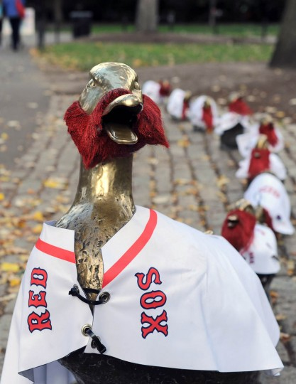 """The """"make way for the ducklings"""" sculptures in Boston Public Garden are dressed in Boston Red Sox jerseys and beards before game two of the MLB baseball World Series against the St. Louis Cardinals at Fenway Park. (Angie Walton/USA TODAY Sports)"""
